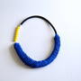 Long black necklace with neon yellow and blue details, fashion statement jewelry, summer necklace