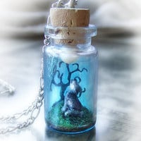 Wolf howling into the moonlight, clay scene bottle necklace