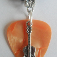 Orange plain Real guitar pick necklace with guitar charm and adjustable chain.