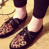 Black suede leopard flat shoe  from OMGLook