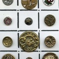 Card of  12 metal vintage and antique floral buttons