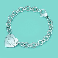 Tiffany &amp; Co. -  Return to Tiffany medium heart tag on a bracelet in sterling silver, medium.