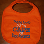 Cape bib in orange with blue and white writing