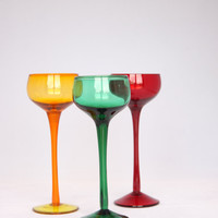 Stunning mid century colourful aperitif glasses, modern red yellow and green glasses on a high base