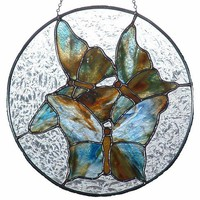 "Butterflies with blue and brown tones in a 12"" round panel"