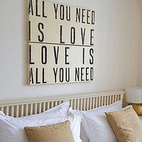 &#x27;all you need is love&#x27; wooden sign by box brownie trading | notonthehighstreet.com