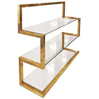 A brass shelve by Milo Baughman