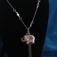 Necklace with an elephant  as a center piece. Elephant pendant necklace. Copper color elephant necklace. Multicolor large necklace.