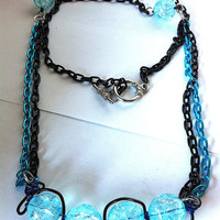 Bright ice  blue crackle glass squiggle necklace