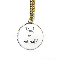 Hunger Games Necklace Real or not real Bronze by MistyAurora