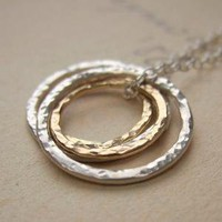 Textures Necklace sterling silver and 14k gold by lazygiraffe