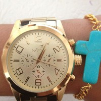 Gold Tone Oversize Watch with Snap Closure