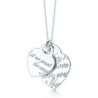 "Tiffany & Co. -  Tiffany Notes ""Let Me Count The Ways"" heart tag pendant in sterling silver."