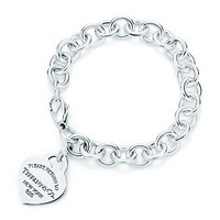 Tiffany &amp; Co. -  Return to Tiffany heart tag charm bracelet in sterling silver.