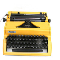 Working typewriter Erika bright yellow vintage home office decor writing writer retro