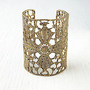 Alkemie  Maltese Lace Cross Cuff at Free People Clothing Boutique