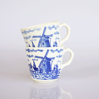 Antique blue willow coffee cups showing a Dutch landscape with windmill