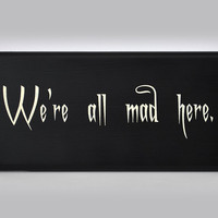We&#x27;re all mad here. Alice in Wonderland, Cheshire cat painted sign