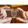 Laser-Engraved Wood iPhone Case Resembling a Camera