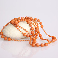 Vintage orange / coral plastic pearl necklace