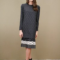 Black vintage polka dot dress with layered pleated skirt trim | shopcuffs.com