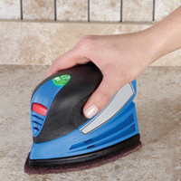 The Handheld Rechargeable Power Scrubber - Hammacher Schlemmer