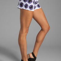 Milly Pinwheel Flowers Print on Stretch Cotton Tab Shorts in Grape from REVOLVEclothing.com