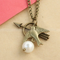 The Hunger Games Necklace  Katniss Bow with Mockingjay by mosnos