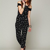 Flynn Skye  Black Ditsy Overall at Free People Clothing Boutique