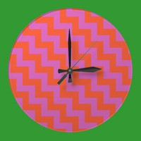Round Wall Clock, Magenta and Orange Chevrons from Zazzle.com