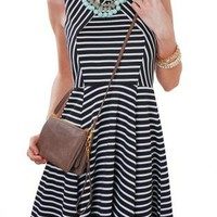 Black & White Sleeveless Striped Dress with Cinched Waist
