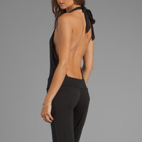 Riller & Fount REVOLVE Exclusive Nadja Halter Boot Cut Jumpsuit in Black from REVOLVEclothing.com