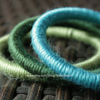Three Yarn Wrapped Bangle Bracelets - Dark Green, Light Green, and Light Blue