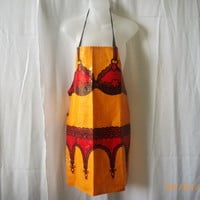 Vintage orange PVC apron featuring red bra and garter belt