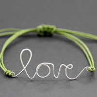 I Love You Bracelet : Barnyard Grass. Silver Handwritten Cursive Wire 'LOVE' Bracelet with Green Cotton Cord, Adjustable, Crimp Beads