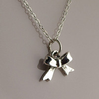 Tiny Silver Bow Necklace by EnchantedWonderland on Etsy