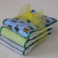 Burp Cloths - choo choo train flannel fabric coordinated with other flannel fabric and green ribbon, sewn on diaper