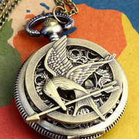 The Hunger Games Logo Mockingjay pendant Victorian by qizhouhuang