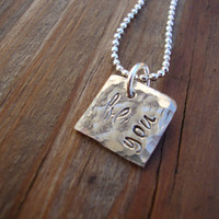 "Dainty silver necklace hand stamped with ""be you"".  So pretty!"