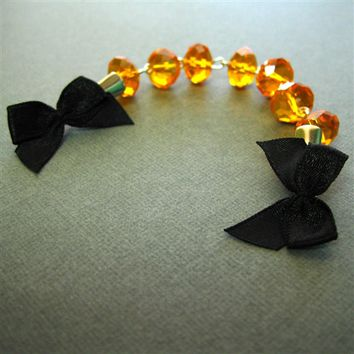 Black Bow and Orange Sweater Clip - Spiffing Jewelry
