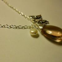 Wire Wrapped Pink Smooth Glass Teardrop Pendant With Pearl And Butterfly Charm