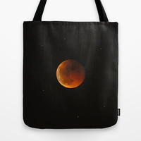 Total lunar eclipse. Red moon Tote Bag by Guido Montañés