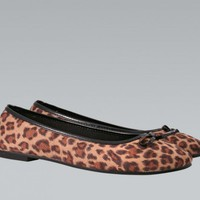 Leopard Print Ballet Flats with Black Bow Detail