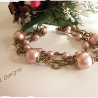Feminine Rose Powder Pearl and Bronze Triple Strand Bracelet