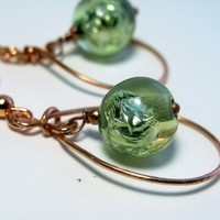 Handforged copper dangle earrings with green glass foil bead