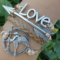 games bracelets,mockingjay pin bracelet,catching fire bracelets,leather bracelet,fashion charm jewlery,arrow bracelet,love bracelet,couple