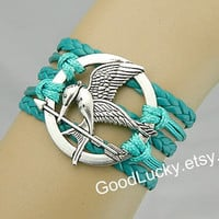 Mockingjay bracelet,Mockingjay pin bracelet,catching fire,green,leather bracelet,Hunger bird,hipster jewelry,Braided Bracelet,Games bracelet