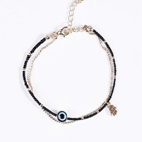 Evil Eye Bracelet in Black at Urban Outfitters