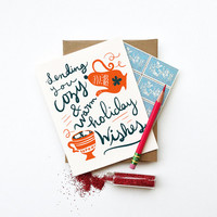 Cozy and Warm Holiday Wishes Card hot cocoa mug teapot illustration red blue white typography calligraphy christmas hanukkah new year