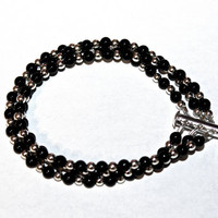 Black Crystal Pearl and Silver Plated Bead Bracelet. Three Strand Bracelet Contains Black Pearls and Silver Plated Brass Beads. Stylish.